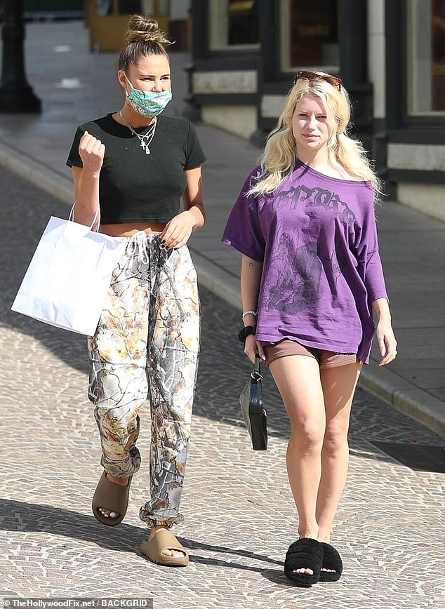 Casual: Later Lottie opted for a far less glamorous ensemble as she headed out for a stroll on Rodeo Drive