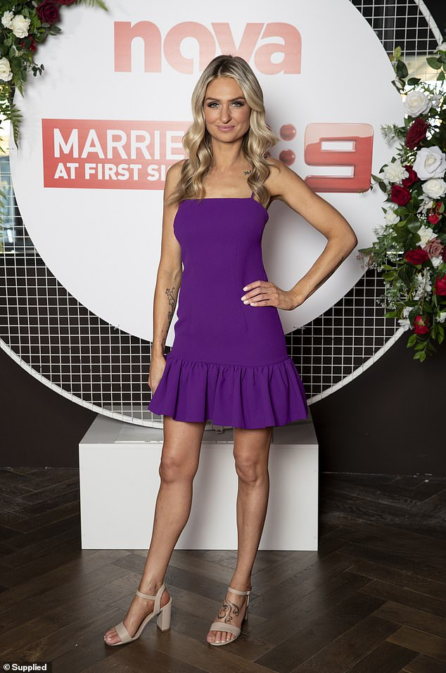 Accessories: The 39-year-old accessorised her dress with a pair of nude heels and styled her long blonde locks in curls