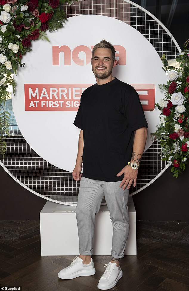 Stylish:The clothing brand owner, 32, made a statement in grey pants, a black T-shirt and a pair of white sneakers
