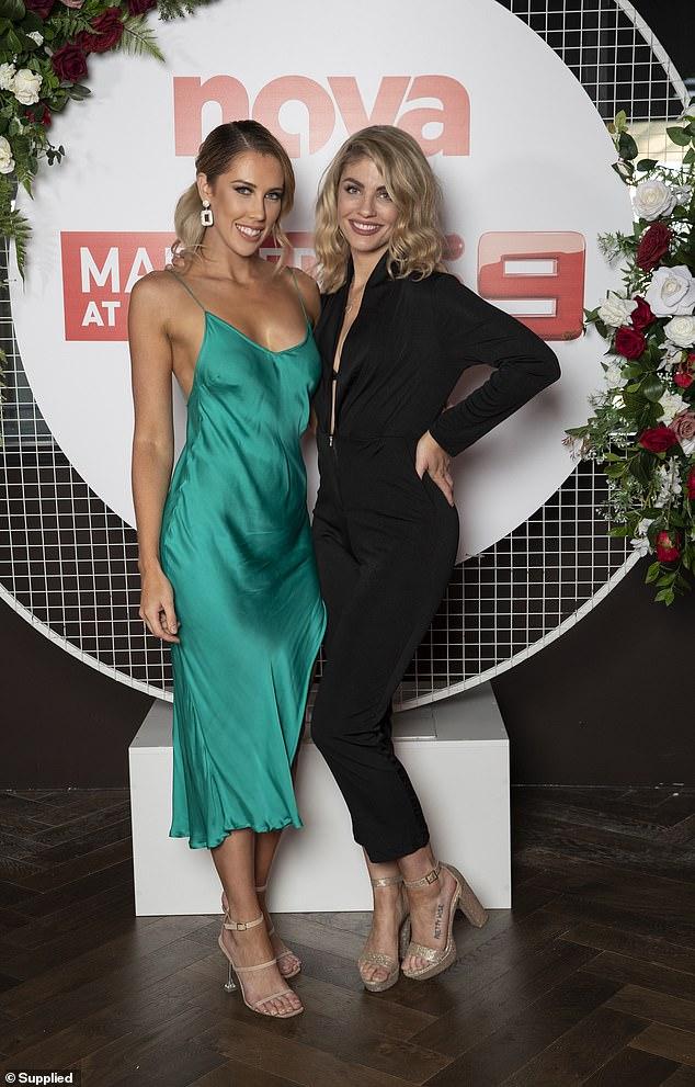All smiles: The blonde bombshell was all smiles as she posed alongside co-star Rebecca Zemek (left) at the event