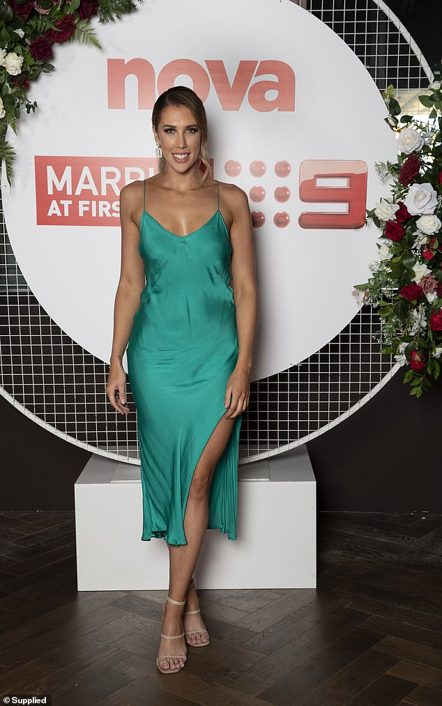 Green with envy!Beck, 27, made a style statement in a long silk green dress which features a slit on the side