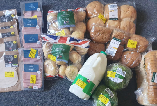 CATERS NEWS (PICTURED- Clare's purchases should have cost ??22.70 but she got it all for ??3.86) - This savvy bride-to-be is using yellow sticker shopping to slash the price of her food shop to save for her dream wedding. Mum-of-two, Clare Greaves, 37, from Leeds, has been using yellow sticker food bargains so that she can set aside more money for her dream wedding next year. Before she began hunting for yellow sticker bargains, Clare says that she would spend over ??150 each week on food shopping for her family. However, since using her thrifty techniques, Clare has been able to reduce the price of her shop by over half and is saving more than ??70 each week to go towards her wedding with her partner, Nick. - SEE CATERS COPY