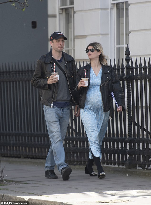 Laidback look: George was casually-clad in a navy baseball cap, light-wash jeans and a khaki jacket