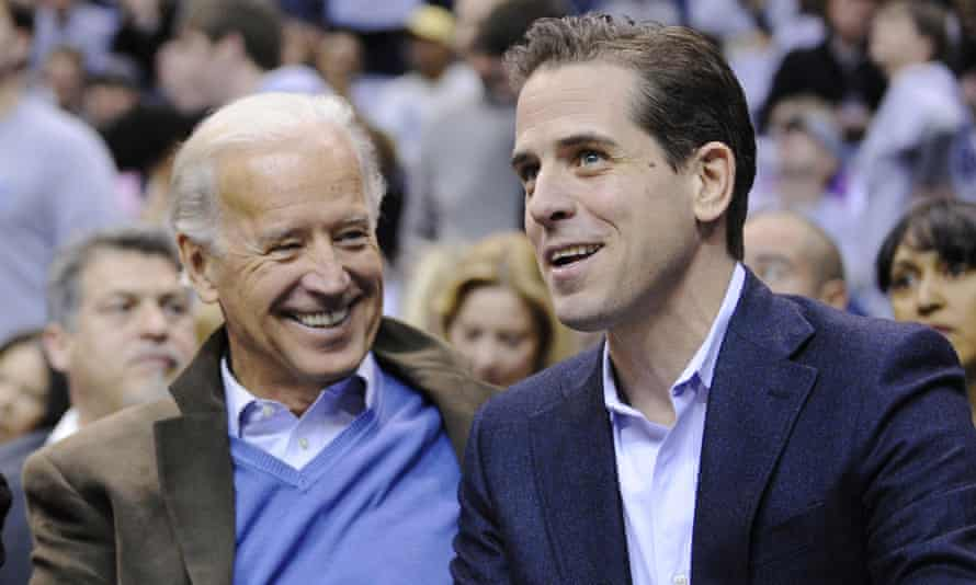 Then Vice President Joe Biden, left, and his son Hunter Biden appear at the Duke Georgetown NCAA college basketball game in Washington in 2010.