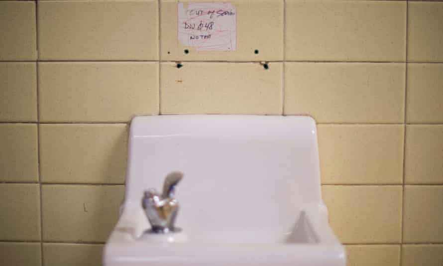 A placard posted above a water fountain warns against drinking the water at Flint Northwestern High School in Flint, Michigan, May 4, 2016.