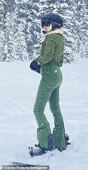 Taut tummy: Roberts slipped her slim post-baby body into a Perfect Moment Sports green snowsuit