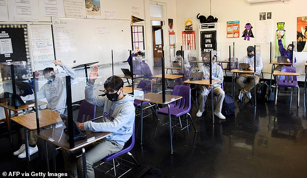 School-acquired coronavirus infections made up 3.15% of all cases in the first scenario, 4.19% in the second and 2.37% in the third. Picturde: Students attend an in-person English class at St Anthony Catholic High School in Long Beach, California, March 24