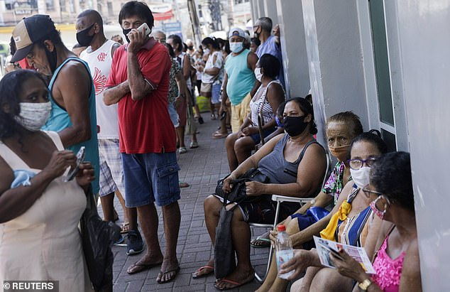 Brazil has had one of the worst Covid outbreaks in the world, with more than 12million cases and 300,000 deaths (Pictured: People queue for vaccines near Rio de Janeiro in March)