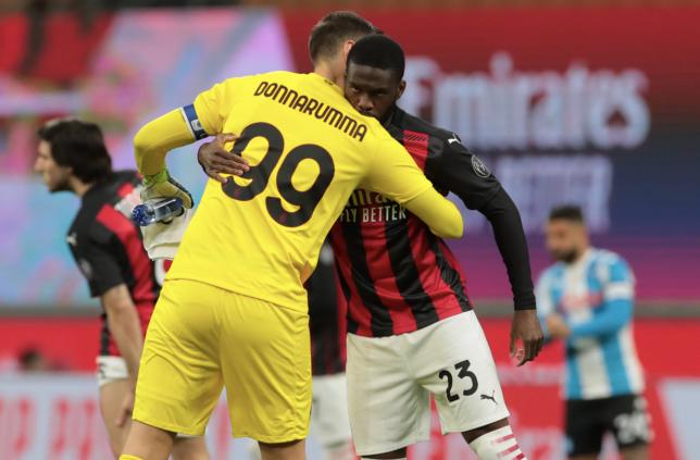 AC Milan goalkeeper Gianluigi Donnarumma hugs Chelsea loanee Fikayo Tomori