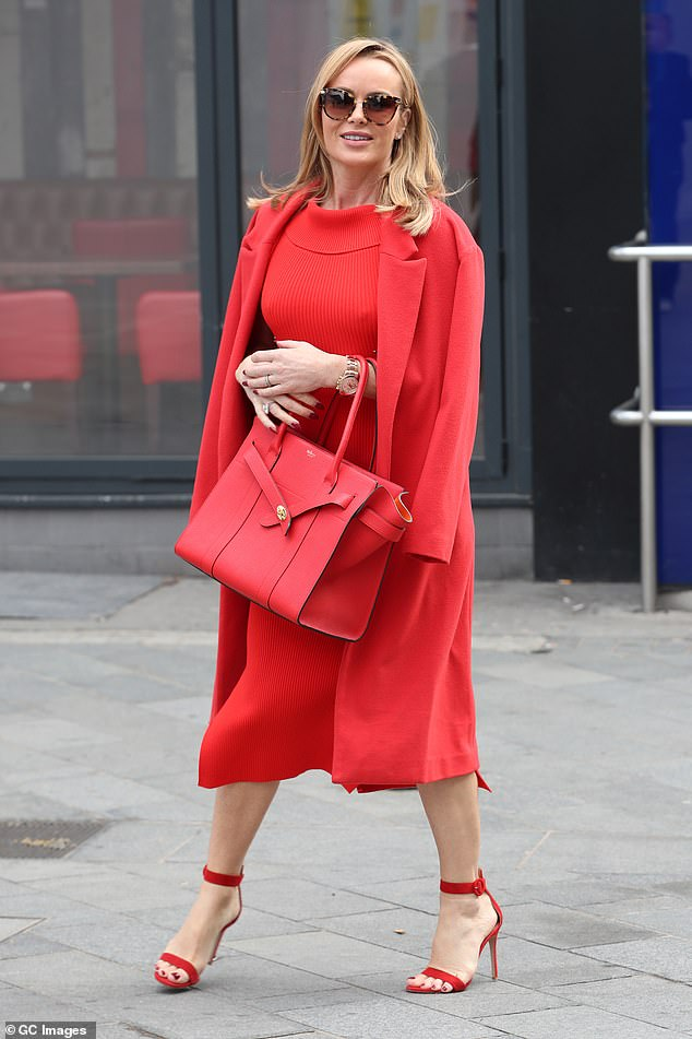 Wow-factor:Amanda Holden started the week with a bang as she left Leicester Square's Global Studios in a stunning outfit following her Heart Breakfast show on Monday