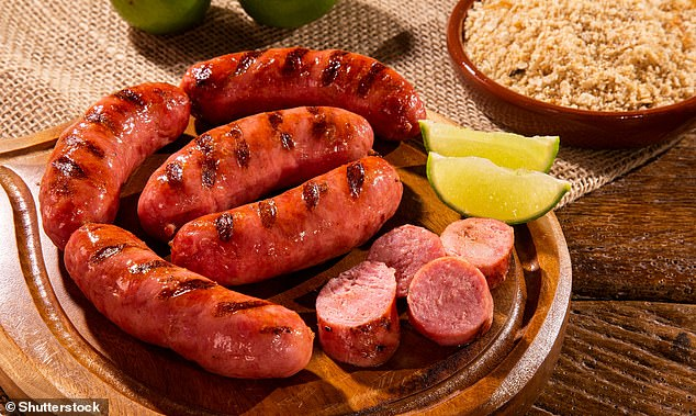 Processed meats include sausages, salami and cured bacon, pâté and beefburgers. Processed meats are generally high in fat and are often high in salt too. Pictured, grilled sausage at a Brazilian barbecue (stock image)