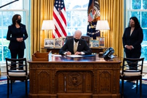 Joe Biden signs the PPP Extension Act of 2021 into law in the Oval Office.
