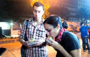 Leyla Kazimand her husband Matt eating vada pavs in Mumbai