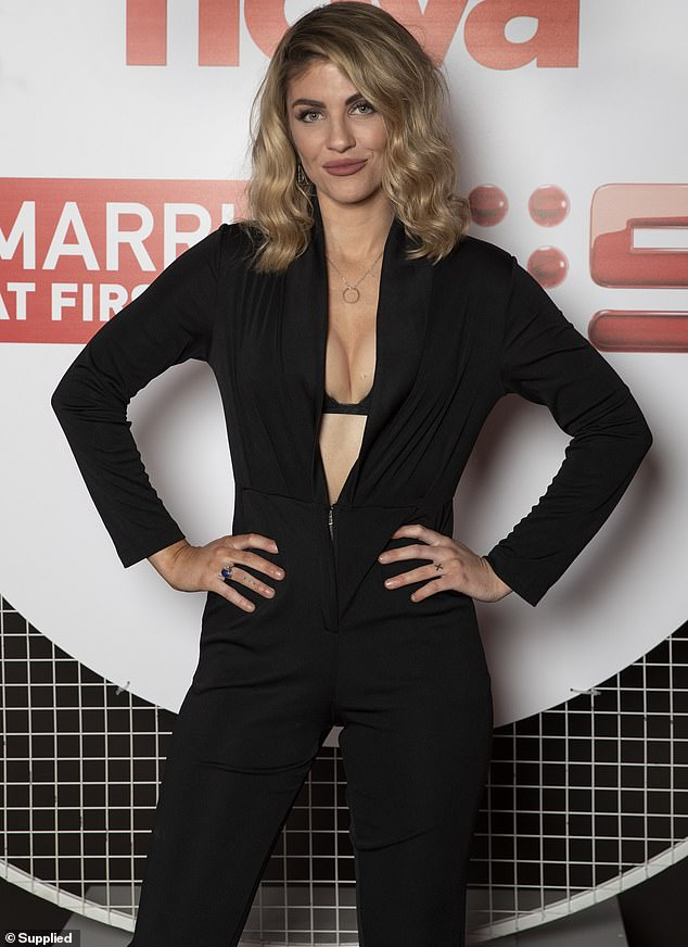 A bombshell in black! Married at First Sight's Booka Nile (pictured) flashed her black bra in a plunging jumpsuit as she attended an event in Melbourne on Tuesday