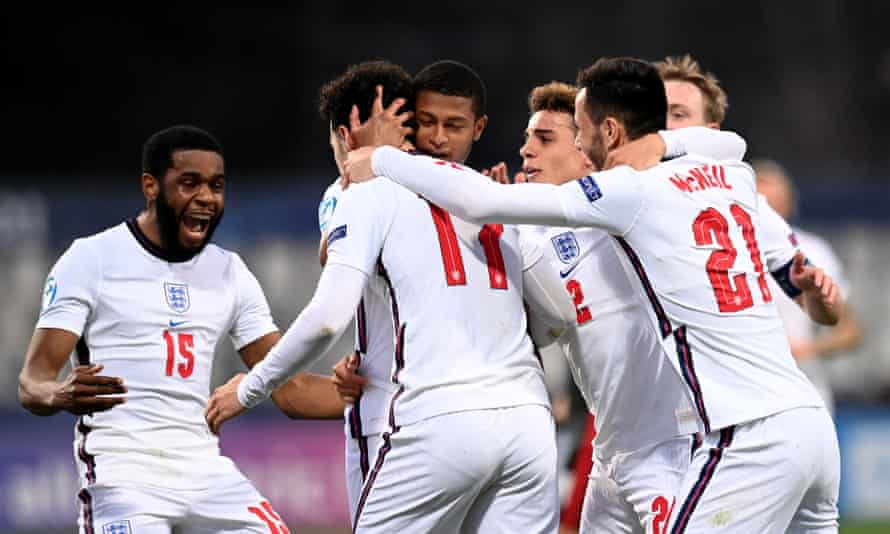 Curtis Jones (No 17) celebrates with his teammates after putting England 2-0 up.