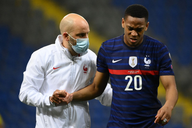 France's forward Anthony Martial (R) receives assistance after an injury during the FIFA World Cup Qatar 2022 qualification Group D football match between Kazakhstan and France, at the Astana Arena, in Nur-Sultan, on March 28, 2021. (Photo by FRANCK FIFE / AFP) (Photo by FRANCK FIFE/AFP via Getty Images)