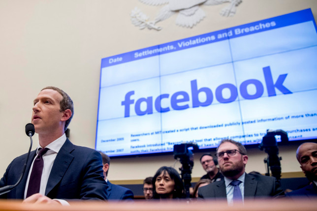 Facebook CEO Mark Zuckerberg testifies before a House Financial Services Committee hearing on Capitol Hill in Washington. (Credits: AP)