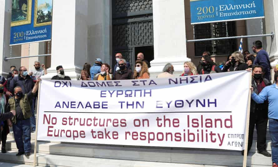 Protesters hold a banner at the town hall in Lesbos during the visit of EU home affairs commissioner Ylva Johansson to Lesbos on 29 March.