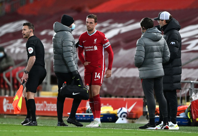 England star Jordan Henderson struggles with a groin injury during Liverpool's Premier League clash with Everton