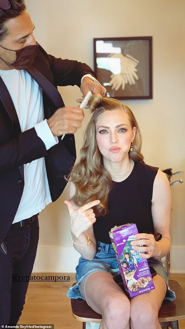Globe preparations:Amanda Seyfried was in the glam chair as she got her makeup done for the show. The Mama Mia! actress wore a black top as she ate Girl Scout Cookies