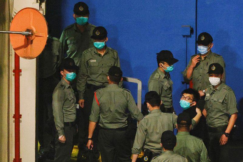 Hearing for Hong Kong democracy activists resumes after marathon session