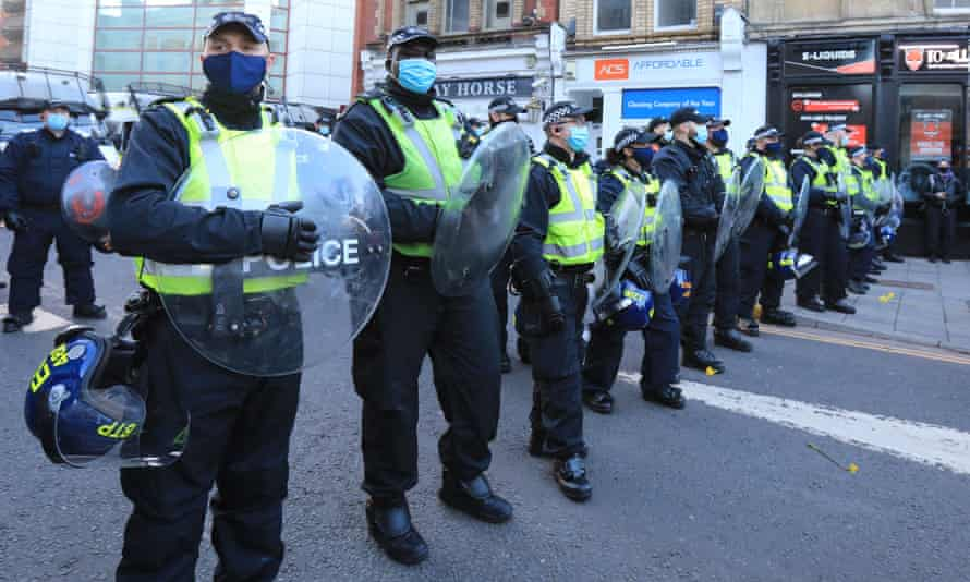 Officers stand guard during 'kill the bill' demonstration in Bristol.