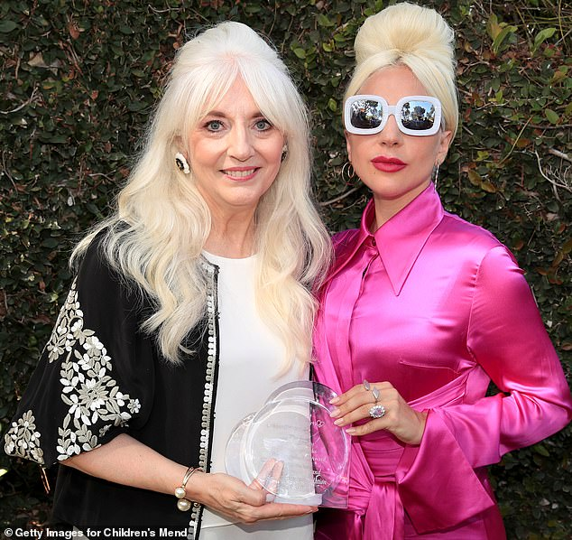 Family resemblance:Lady Gaga's (right) mother Cynthia Germanotta (right) has revealed that 'everyone is doing as well as they can' after the dognapping crisis last month