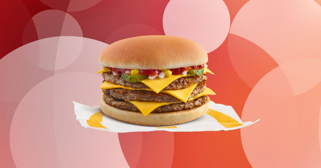 McDonalds triple cheeseburger on pink background