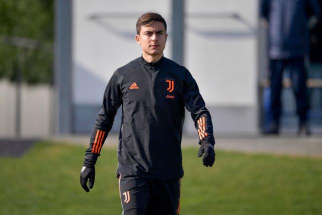 Arsenal transfer target Paulo Dybala looks on in Juventus training