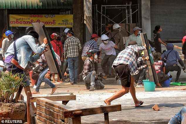 At least 13 people have died after security forces in Myanmar opened fire on pro-democracy protesters in the centre of the country (pictured, protests in Mandalay)