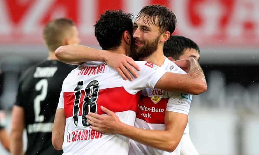 Nat Phillips congratulates the goalscorer Hamadi Al Ghaddioui during Stuttgart's 5-1 win against Sandhausen in June 2020.