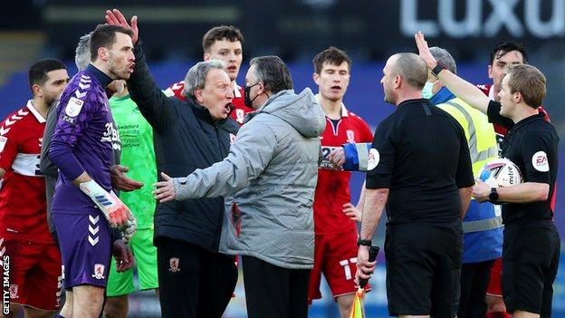 Neil Warnock lead Middlesbrough's protests after Swansea's contentious late penalty