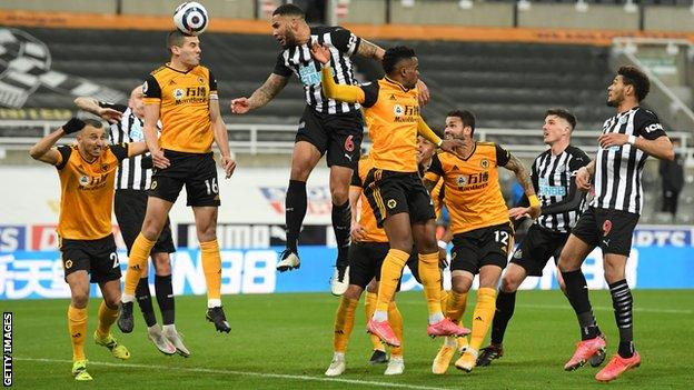 Jamal Lascelles scores Newcastle's goal against Wolves