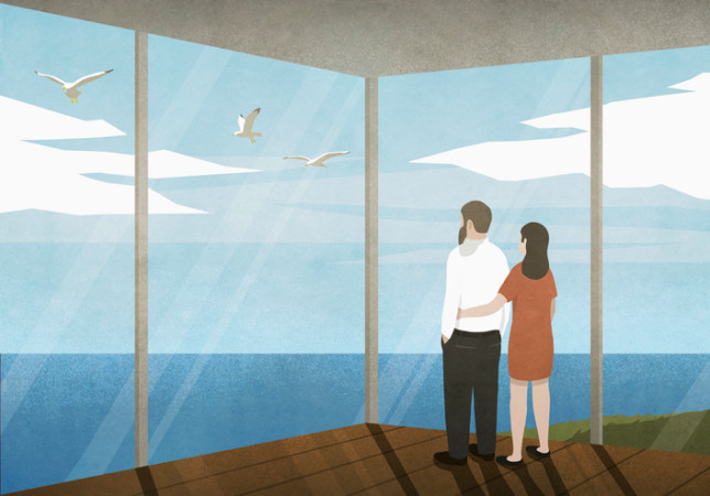 Couple enjoying ocean view from beach house