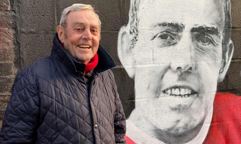 Ian St John pictured late last year alongside a mural of himself. RIP Saint.