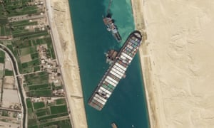 The cargo ship MV Ever Given sits stuck in the Suez Canal. (Photograph: Planet Labs Inc. via AP)