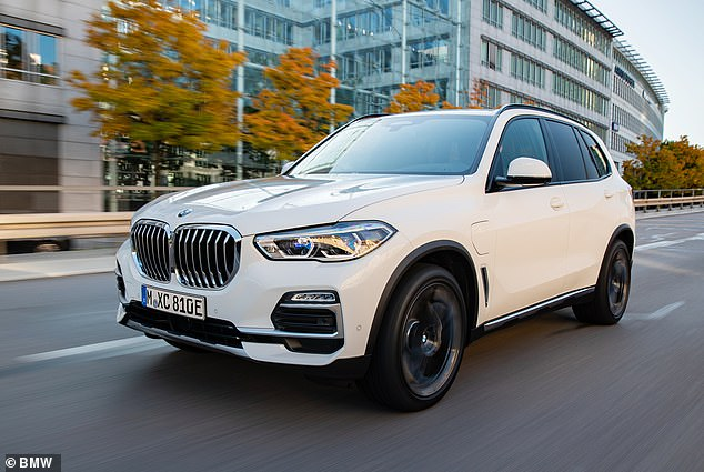 Plug-in hybrid electric cars can use four times more fuel than makers claim, costing owners up to £400 per year more than expected, Which? has warned. Pictured: the BMW X5, which Which? said is 72 per cent less efficient than advertised