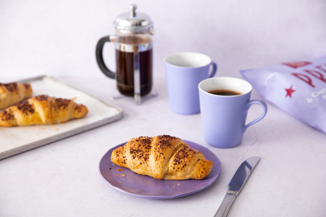Pret chocolate bake at home croissant on a plate with some coffee in mugs
