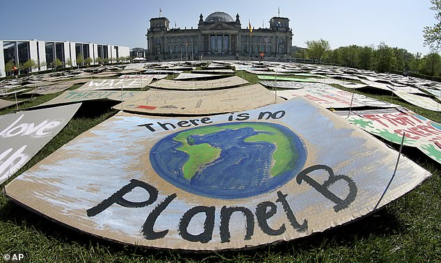 Photo from last year shows climate protest placards in front of the Reichstag building, home of the German federal parliament, in Berlin, Germany