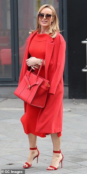 Commanding attention: The Britain's Got Talent judge strutted across the streets of London in her statement number, which also featured a designer handbag