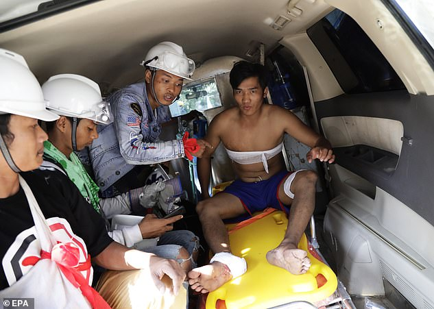 Clashes also broke out between protesters and security forces in Yangon, the country's biggest city, leaving dozens wounded (pictured)