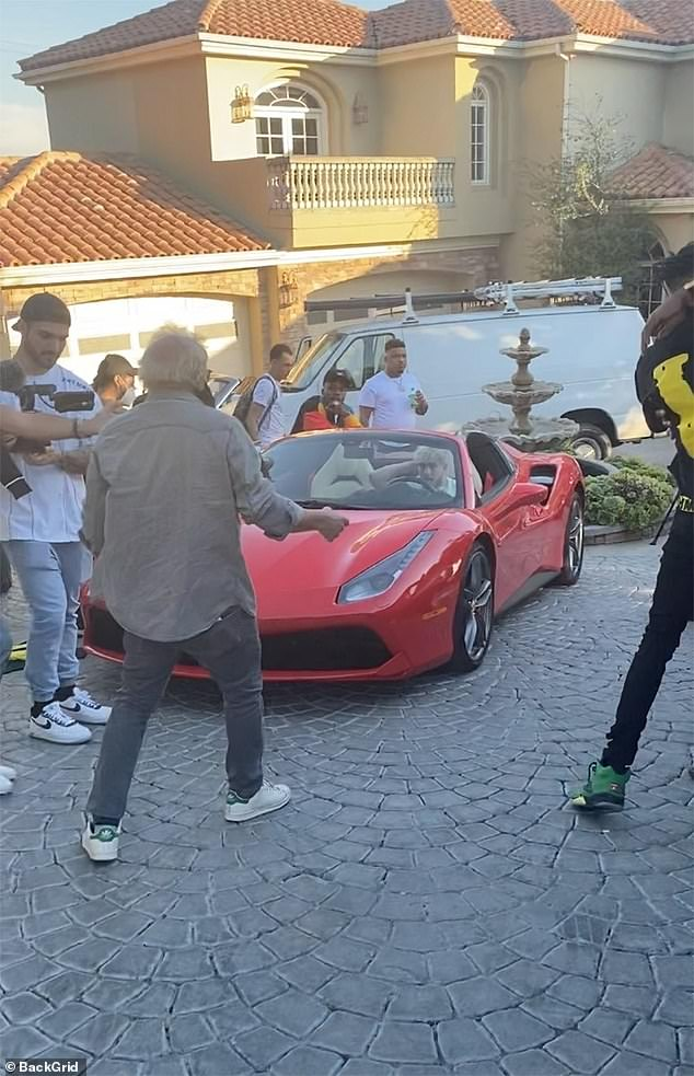 Jake Paul and Da Baby were seen sitting in a convertible outside the abode