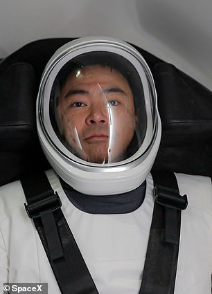 Japan Aerospace Exploration Agency astronaut Akihiko Hoshide trains inside a mockup of the SpaceX Crew Dragon vehicle during a training session at the SpaceX training facility