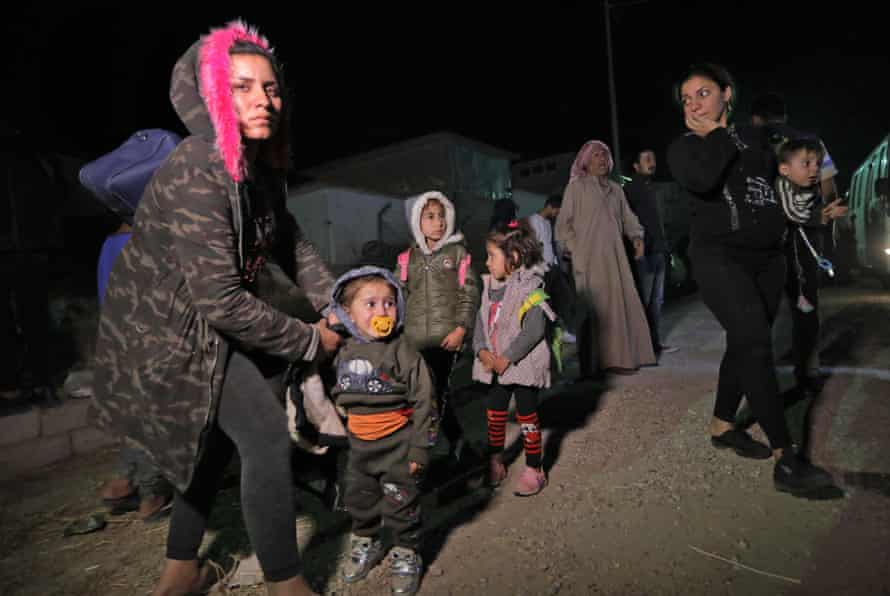 Syrians displaced by Turkish military operations in north-eastern Syria arrive at a refugee camp near the Kurdish city of Dohuk, in Iraq's autonomous Kurdish region, in October 2019.