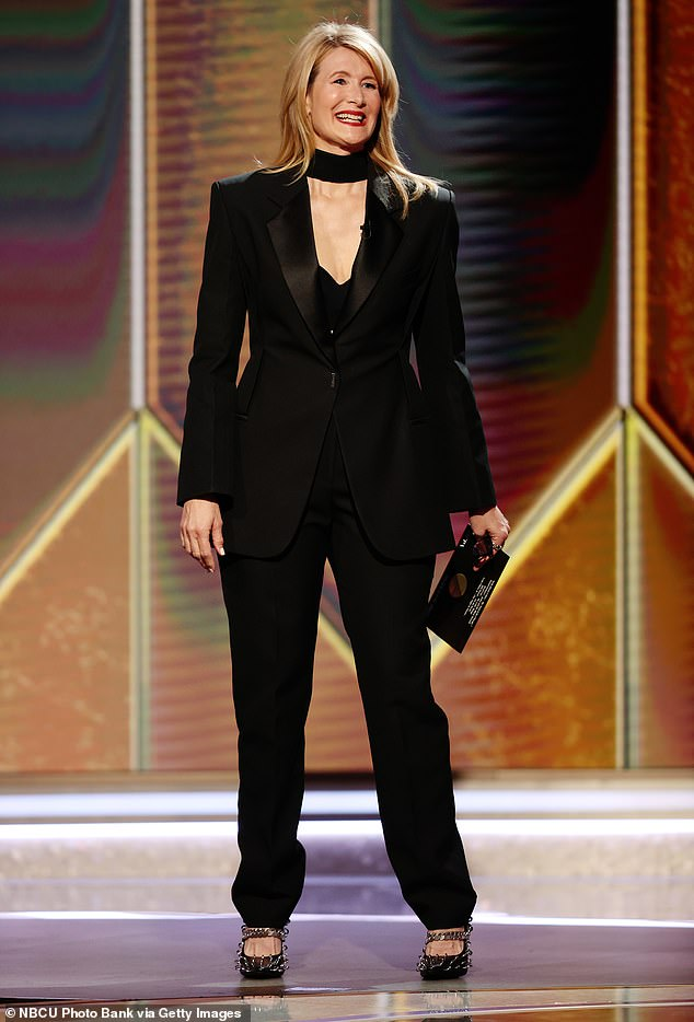 She kept it simple: Instead of a colorful gown she wore a black suit with heels