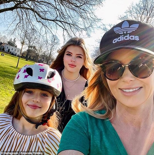 Family first:Over the weekend, the blonde enjoyed a relaxing bike ride with her daughters Alexa, 15, and Hollie, nine