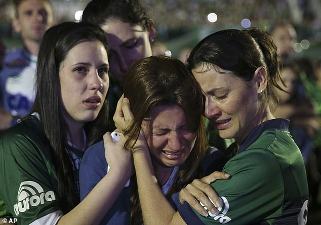 Nineteen members of Brazil's Chapecoense football team were killed in the crash. Pictured: Relatives of the players cry during a memorial service inside the Arena Conda stadium in Chapeco, Brazil on November 30, 2016 [File photo]