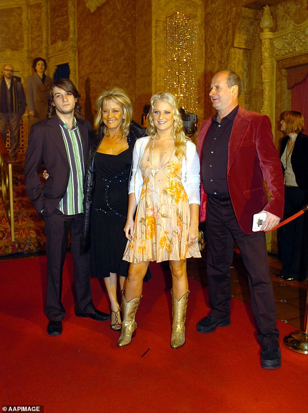 Gudinski is pictured with his wife and children inJuly 2005