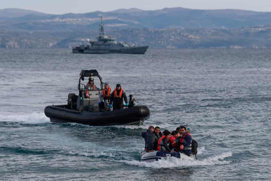 A dinghy with 15 Afghan refugees, 5 children, 3 women and 7 men, approaches the Greek island of Lesbos on February 28, 2020 next to UK Border Force patrol boat HMC Valiant (background), a cutter patroling in Agean sea under European Union border force Frontex. - The head of the European Union's border and coast guard agency faces a grilling on Tuesday, Dec. 1, 2020 by EU lawmakers as pressure mounts over allegations that Frontex was involved in illegal pushbacks aimed at preventing migrants or refugees entering Europe through the Greek islands.