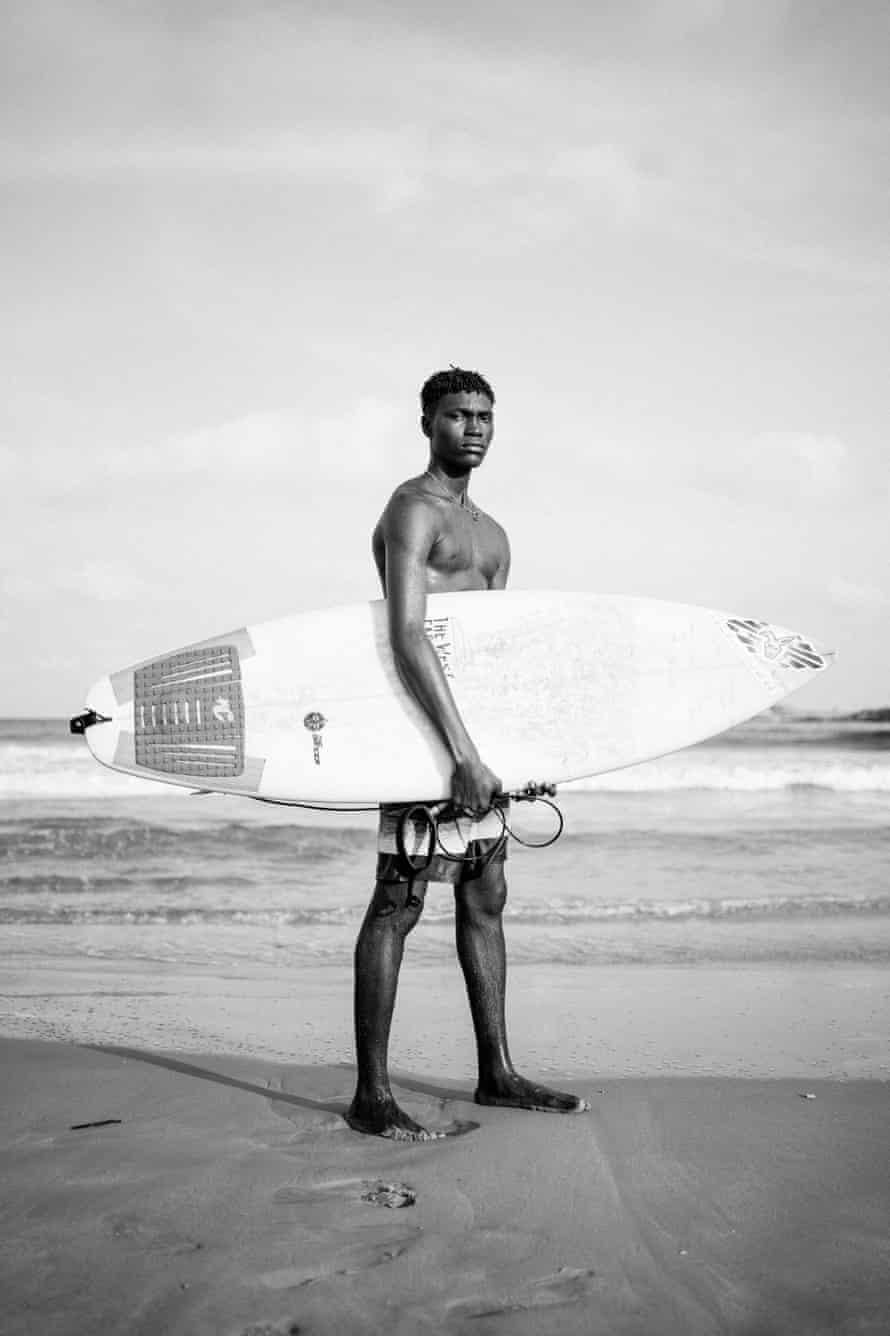 A surfer on Tarwka Bay beach, Nigeria.